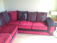 Red and black 3/2 seater corner suite, 2 small defects,