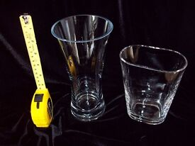 Vases: 2 x Glass Vases, one Concave approx. 8 inches tall the other Oval approx. 6 inches tall.