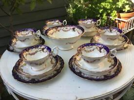 Beautiful vintage blue and gold set of 6 trios plus large bowl