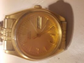 Ladies Seiko gold face quartz with day and date window