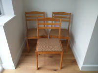 3 x solid wood dining chairs with patterned seat pads