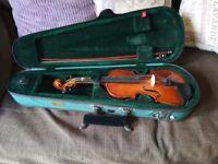 Violin for sale. Small sized children's violin in good condition. With bow, case and chin rest. £10