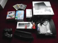 PS3, 4-port USB Slim Stand, 2 x controllers, PS Move Motion Controllers, PS eye camera, 3 x games