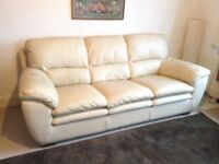 Cream three seater leather sofa in good condition 2.1 mts long