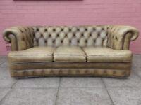 A Light Green Serpentine Leather Chesterfield Three Sofa Sofa