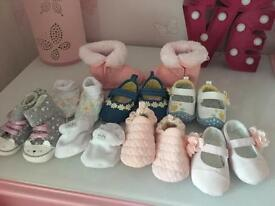 8 pairs of baby girls shoes never worn.