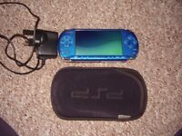 SONY PSP AND CASE AND A GAME AND CHARGER
