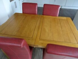 Extendable oak table with four chairs