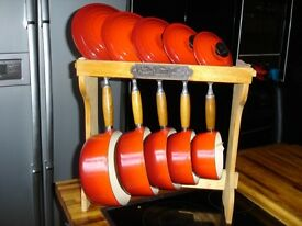 Le Cruset 5 piece pan set with stand. As new these pans have never been used