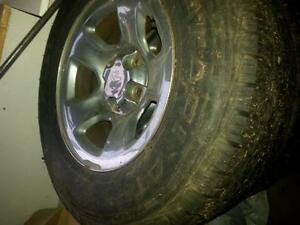 dodge 1500 chrome rims with 265/70/17 tires. also full size spar