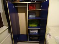 blue wardrobe with shelves