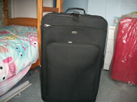 Trolley Suitcase. Weighs 4kgs.