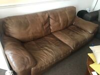 Brown leather sofa and two matching armchairs