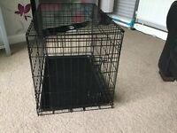 Medium dog cage.