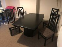 Extending Black Dinig Table with 4 chairs