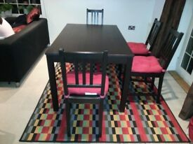 Ikea Wooden dining table with 4 chairs and cushions. Excellent condition.Used for 4 yrs.