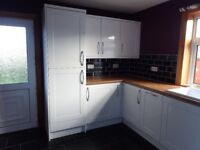 Kitchen cabinets with fridge and freezer in excellent condition