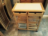 Mini kitchen island on wheels with vegetable storage, wine rack and drawers
