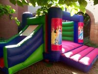 Velcro bouncy castle with slide on side.