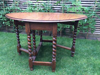 Great charming drop leaf antique solid wood table