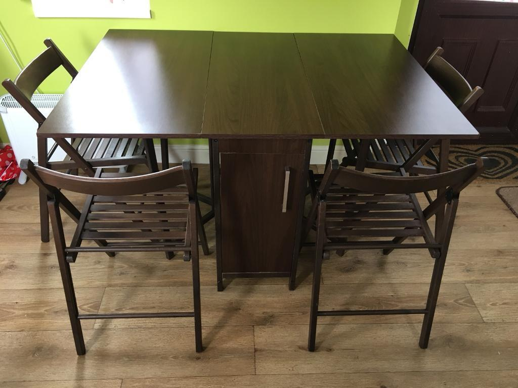 Space Saving Folding Chocolate Brown Dining Table And Folding Chairs