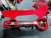 Sitar with hard case.