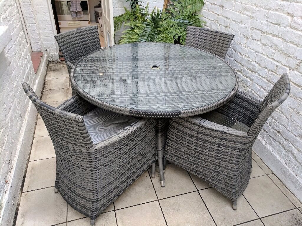 Rattan style table and 4 chairs excellent condition victoria