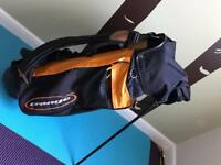 Orange golf stand bag with hood, used but good condition