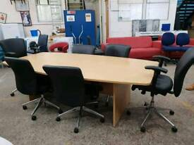 Large boardroom table with 6 black leather chairs