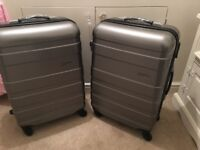 Silver samsonite hard shell suitcases x2