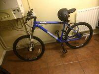 Voodoo Bantu mountain bike. Blue. Only ridden once. Mint condition. Includes lights, lock, helmet