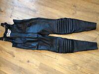 Ladies black leather bib & brace.