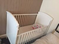 white wooden cot with mattress and sheets
