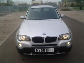 Silver bmw x3 75,700 mls .excellent condition .