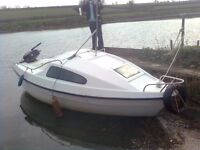 2 berth cabin cruiser with boat trailer and outboard engine