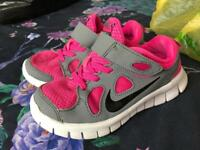 Pink and grey Nike free run kids trainers size 11
