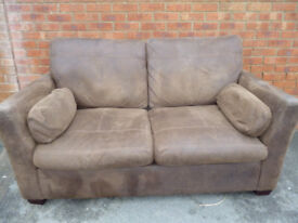 2 SEATER SOFA BED CHOCOLATE SUADE- MATTRESS HAS ONLY BEEN USED TWICE.....
