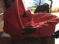 Red quinny buzz carry cot. In good condition.