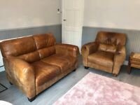 Tan aged leather sofa and chair