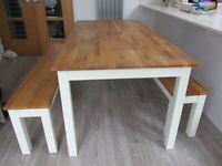 Nearly new dining table with benches.
