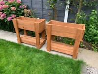 Pair of raised wooden garden planters very well made with bottom shelf