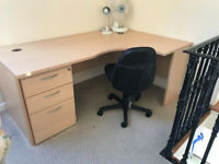 Clean, corner desk and filing cabinet with chair