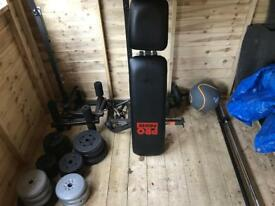 Various weights / bars / bench / ball