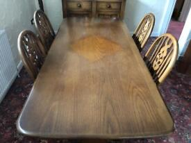 Solid wood dining table complete with 4 chairs