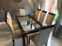 Glass dining table and 8 chairs