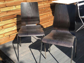 Two dining chairs, dark brown wood seat with chrome legs