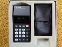Vintage Sinclair Scientific Programmable Calculator, boxed, and in excellent condition