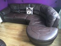 Leather corner sofa 4-5 seater brown. Has had a tear repaired see photos but still comfortable