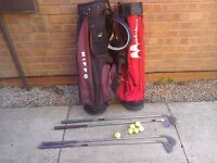 Two golf bags ,clubs and balls