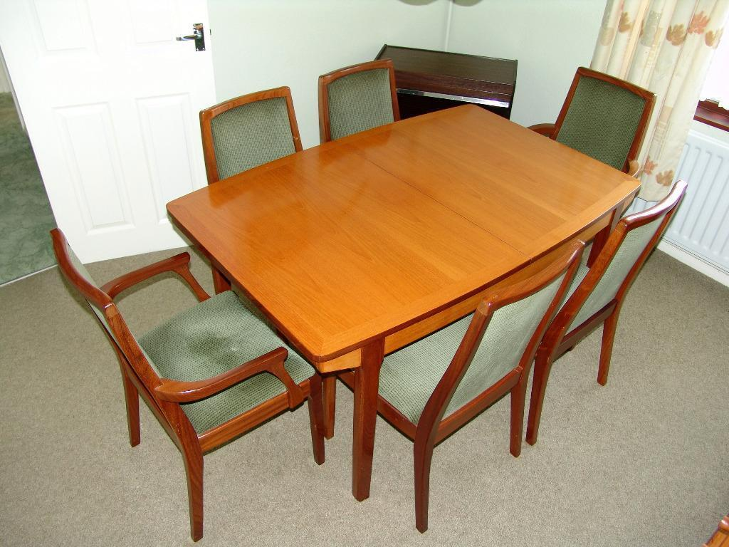 Nathan classic teak dining room table with 8 chairs for Dining room tables on gumtree